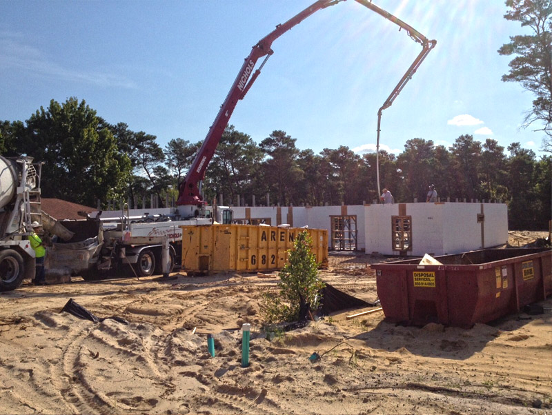 Pouring icf walls with concrete at tucker lot in destin for Icf construction florida
